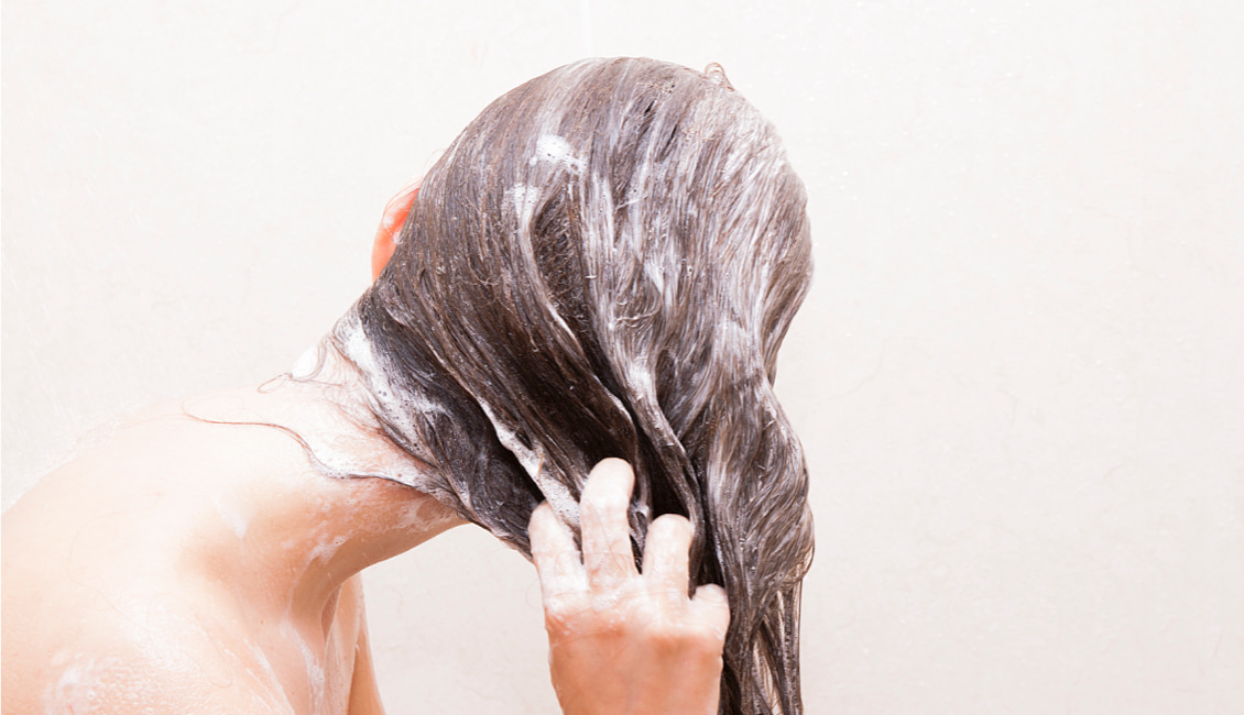 Washing your hair with cooler water can help save your color and keep it vibrant.